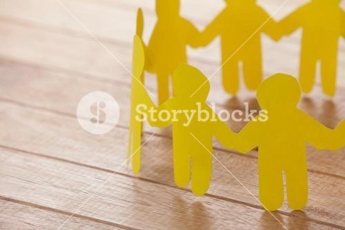 Paper cut outs forming a circle on wooden background