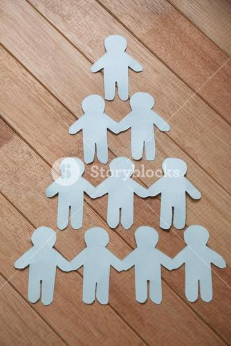 Paper cut outs forming human pyramid