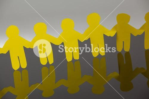 Paper cut outs forming a human chain