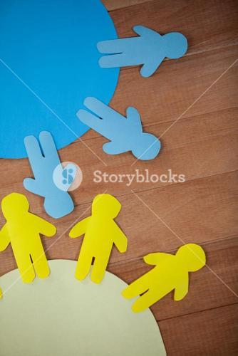 Blue and yellow paper cut-out people on the circle