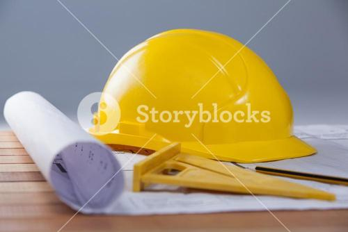 Architectural plan with tools and hard hat