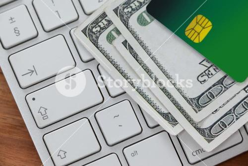 Smart card with currency notes on laptop