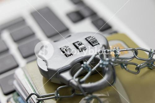 Smart cards locked in chain on laptop