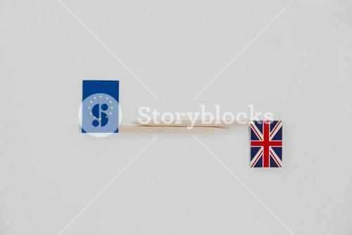 Small sticks with union jack and european union paper flag