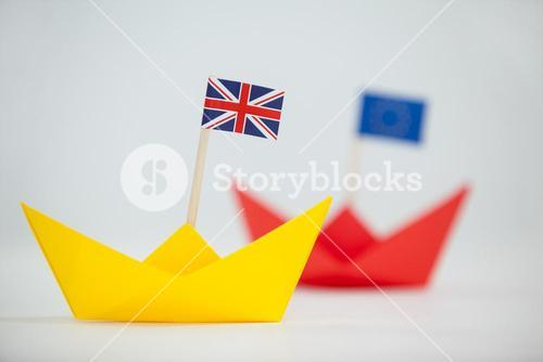 Yellow paper boat with union jack flag