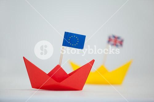 Red paper boat with european union flag
