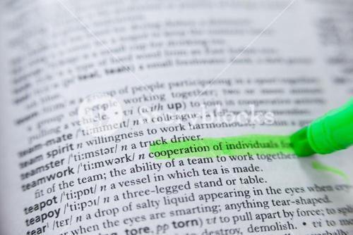 Highlighted definition of teamwork in dictionary