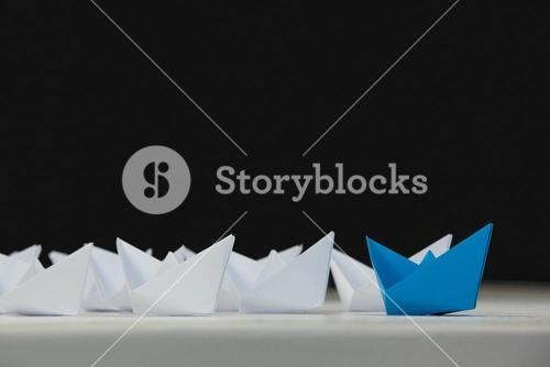 Paper boats arranged together