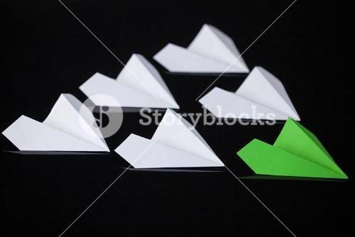 Paper airplanes arranged together