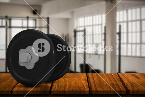 Composite image of metallic dumbbell