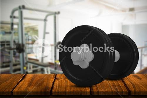 Composite image of black metallic dumbbell