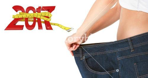 Composite image of woman belly in too big pants