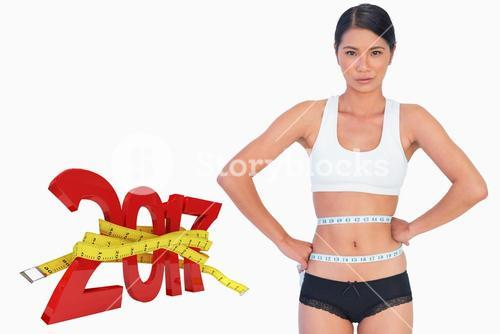 Composite image of slim woman measuring her waist