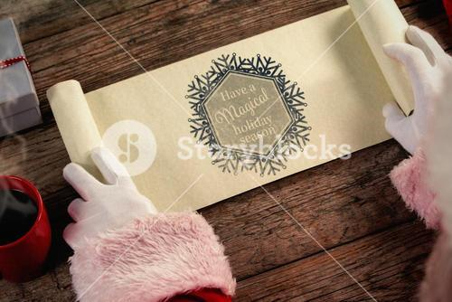 Composite image of close-up of santa claus opening scroll