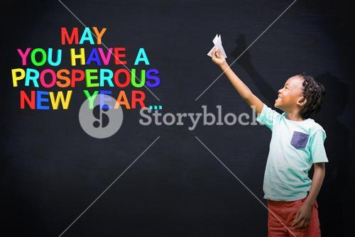 Composite image of child holding paper airplane