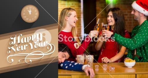 Composite image of smiling friends having drinks during christmas