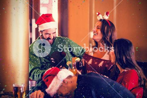 Composite image of festive friends drinking beer and cocktail