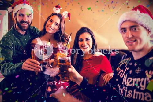Composite image of portrait of friends drinking beer and cocktail