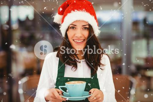 Composite image of portrait of woman with santa hat holding coffee