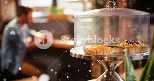 Composite image of focus on cakes in hipster coffee