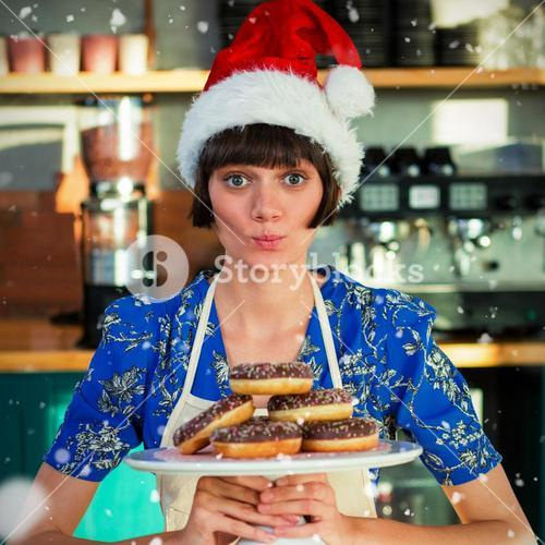 Composite image of portrait of waitress holding tray with doughnuts