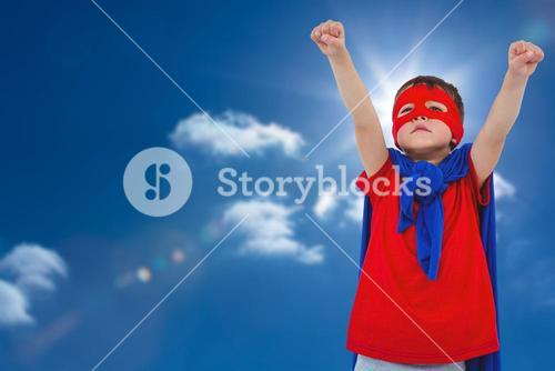 Composite image of masked boy pretending to be superhero