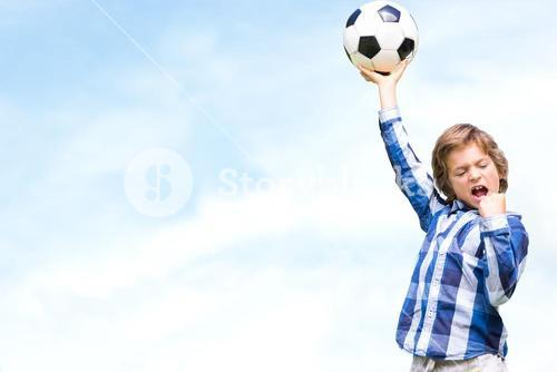 Composite image of child with soccer ball