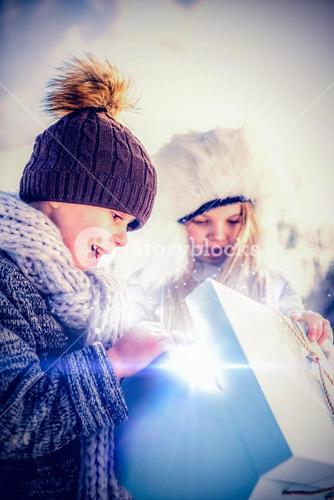 Brother and sister opening present