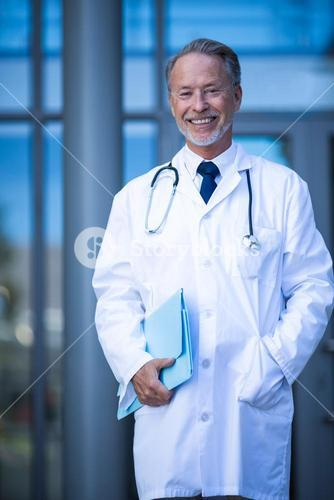 Male surgeon holding file