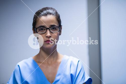 Female surgeon looking at camera