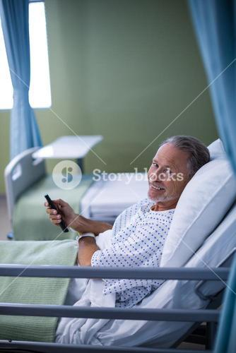 Patient watching television on the bed