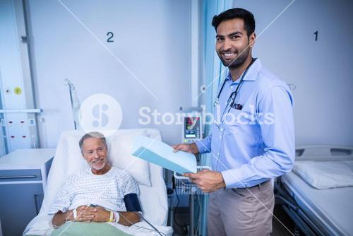Doctor checking medical report of patient