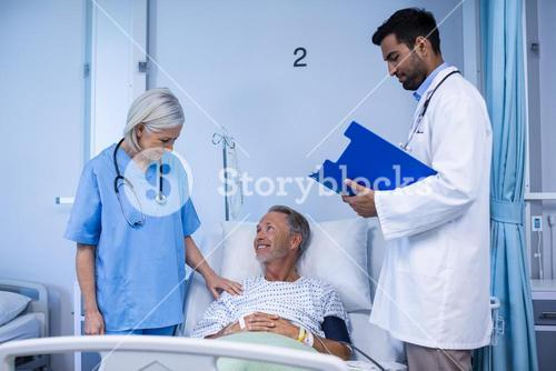Doctor and nurse examining a patient