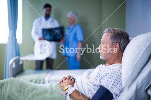 Sick patient lying on bed