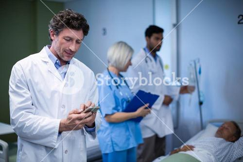 Doctor using mobile phone in hospital
