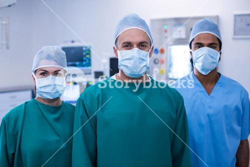 Portrait of surgeons standing in operation room