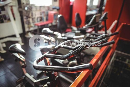 Exercise bicycle in fitness studio