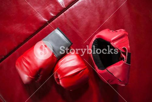 Pair of red boxing gloves and headgear