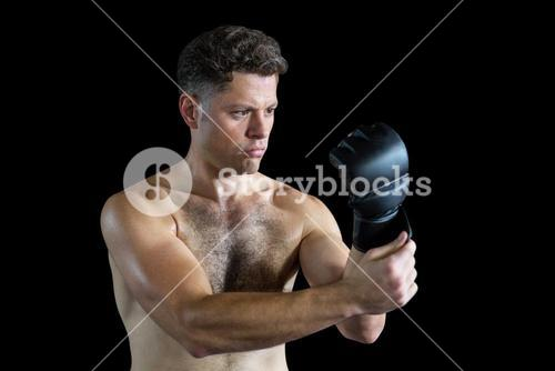 Boxer wearing grappling gloves