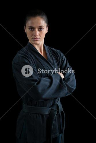 Female karate player standing with arms crossed