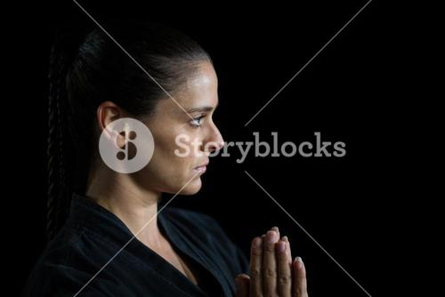 Female karate player in prayer pose