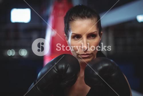 Female boxer performing boxing stance