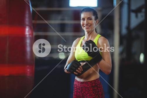 Female boxer wearing mma gloves