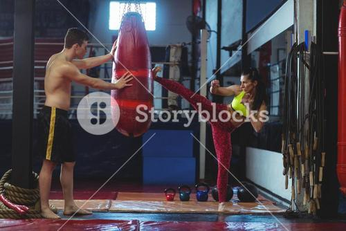 Female boxer practicing a kick boxing