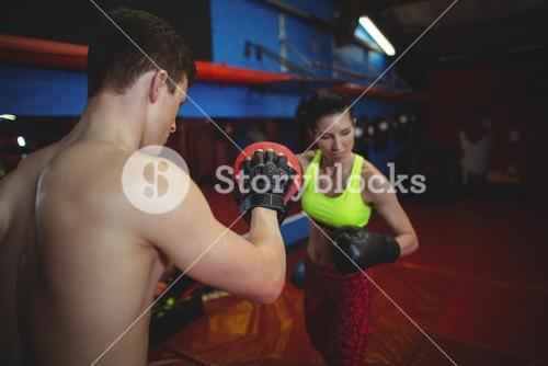 Boxers using focus mitts during training