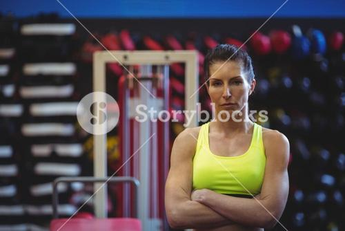 Sportswoman standing with arms crossed
