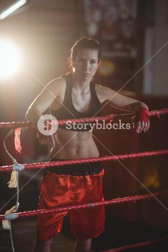 Female boxers standing in boxing ring