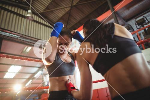 Female boxers fighting in boxing ring
