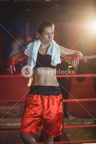 Female boxer standing in boxing ring