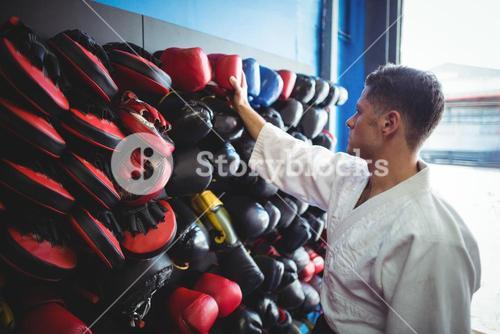 Kick boxer choosing gloves